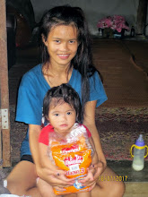 Photo: Mae Ai: baby Toiting (at one year) with mum, Suwannee, (17 years old)