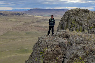 """Photo: """"T"""" on the cliffs of Crown Butte near Simms with Square Butte (and Hutterite colony) in background"""