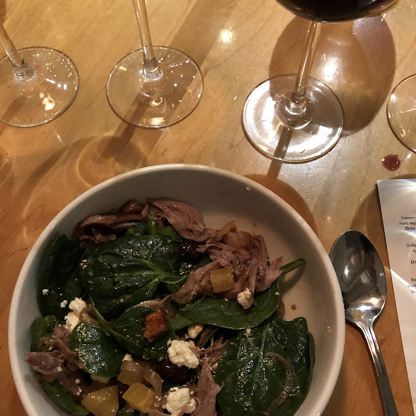 Baby chard and spinach with goat cheese, butternut squash, and duck prosciutto