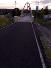 """Photo: Prep: Walking bridge at Sunset. Near Oregon City, on the springwater trail. This was part of our """"test run"""" with our bikes fully loaded with gear."""