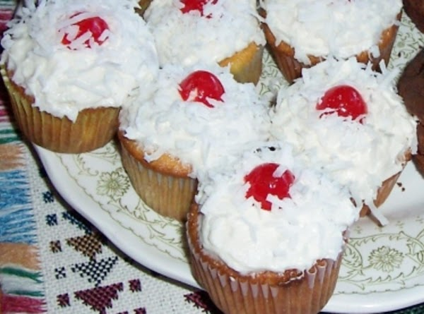 PINA COLADA CUPCAKES: Heat oven 375 degrees. Line w/paper cups 24 muffin cups. In large...