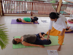 Photo: Jeenal conducting Asanas practice: Yoga teacher trainees performing Matsyasana (Fish Pose).