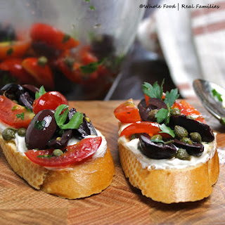 Olive Bruschetta with Whipped Goat Cheese.