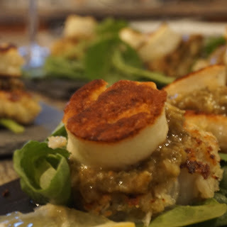 Quinoa Coated Scallops Topped With Grilled Halloumi With A Caper & Raisin Dressing.