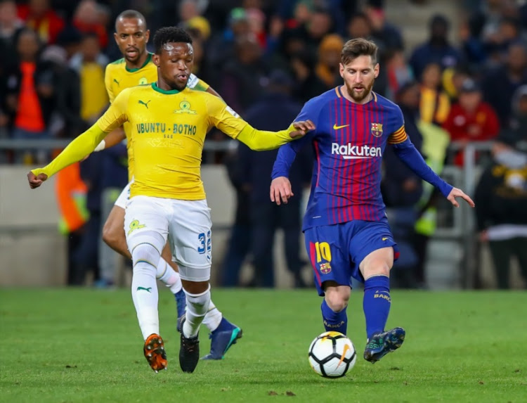 Mojeka Madisha of Mamelodi Sundowns trying to get the ball away from Lionel Messi of Barcelona during the International Club Friendly match between Mamelodi Sundowns and Barcelona FC at FNB Stadium on May 16, 2018 in Johannesburg, South Africa.