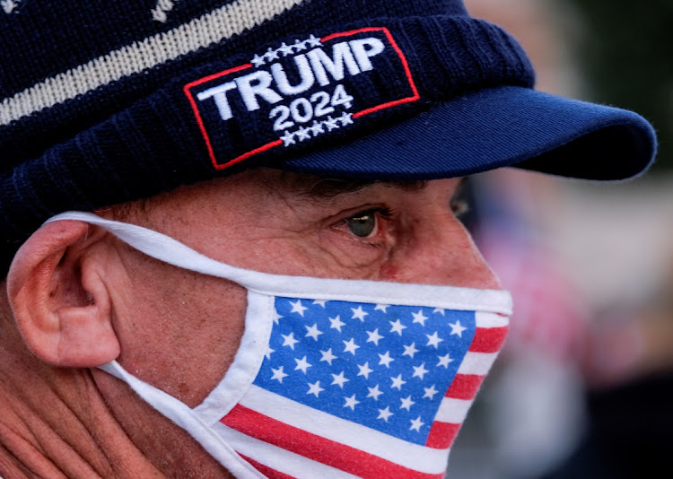 A supporter of U.S. President Donald Trump wearing a face mask takes part in a rally at Beverly Hills Gardens Park in Beverly Hills, California, U.S. January 9, 2021. REUTERS/Ringo Chiu