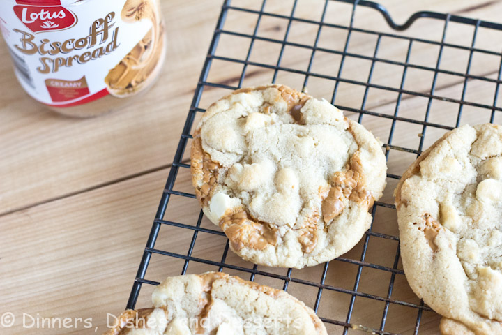 A close up of Biscoff Stuffed White Chocolate Cookies on a cooling rack