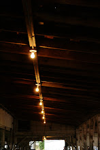 Photo: Rows of lights in a barn