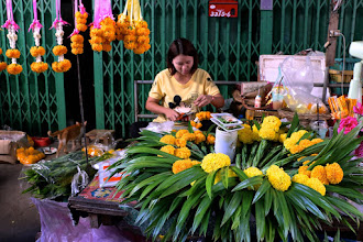 Photo: a flower and garland vendor at Hua Hin morning market