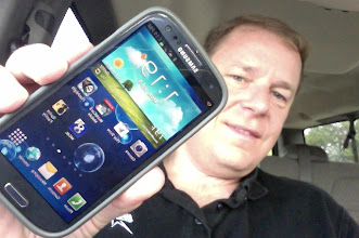 Photo: Brian C. winner of the Samsung Galaxy S3 Giveaway #1 shows off his Pebble Blue Galaxy S3!