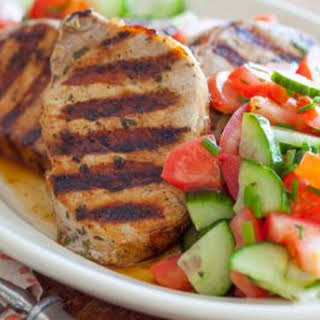 Grilled Greek Style Pork Chops with Tomato Cucumber Salad.