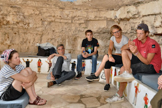 Photo: Exchange of experiences and ideas in small groups in one of the caves