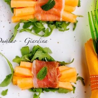 Prosciutto-Wrapped Melon Sticks With Rucola