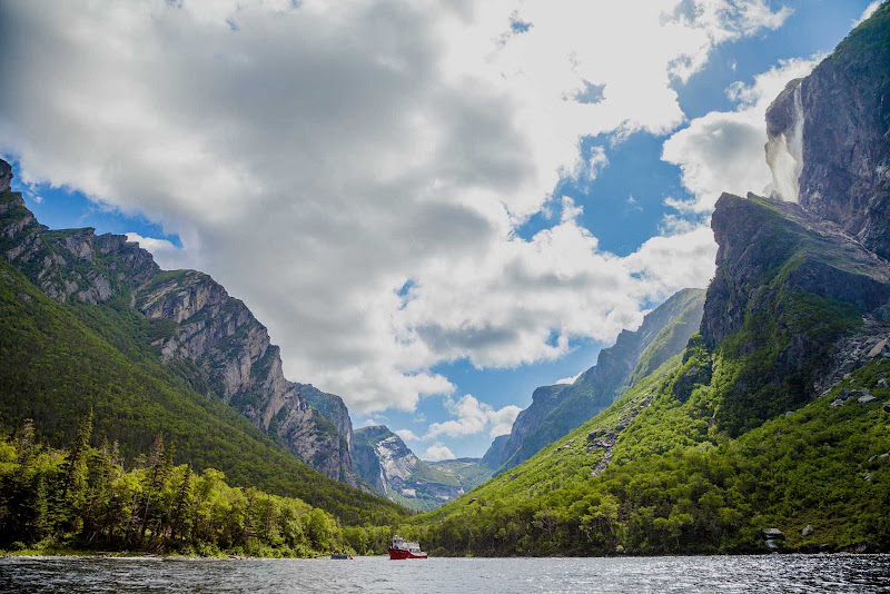 A boat takes visitors on a tour of Western Brook Pond Fjord in Gros Morne National Park, western Newfoundland.