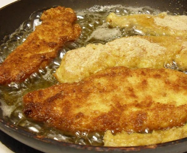 Using a cast iron skillet (if available or traditonal pan), add a generous amount...