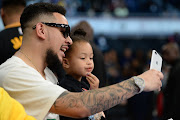 AUGUST 04: South African hip hop artist AKA and daughter Kairo Owethu Forbes during the NBA Africa Game 2018 at Sun Arena, Time Square.