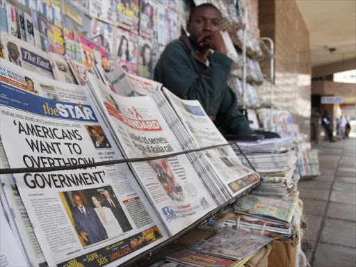 A vendor displays newspapers in a stand in Nairobi.