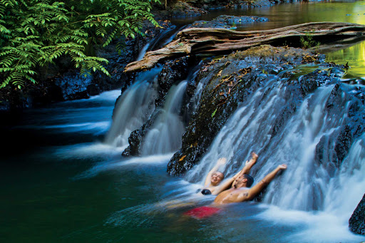 Lindblad-Expeditions-Costa Rica-Waterfall.jpg - Go for a swim underneath one of Corcovado National Park's beautiful waterfalls in Costa Rica.