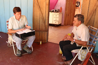 Photo: Pastor Witzke visits with a member of San Pedro in his home.