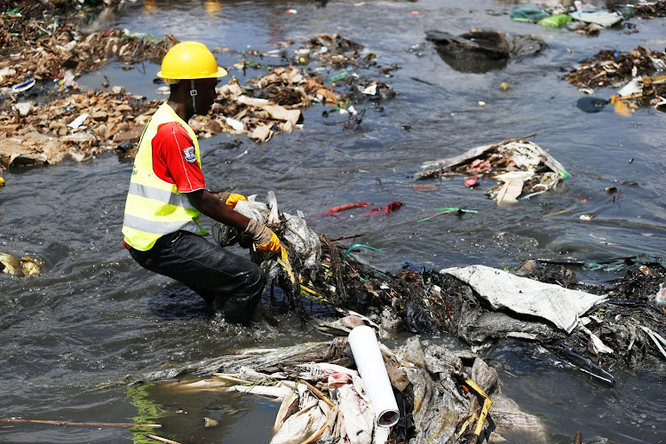 A member of the Nairobi regeneration team that is trying to clean up Nairobi river.