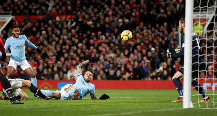 Manchester City's Nicolas Otamendi scores their second goal.