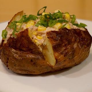 Classic Jacket potato with tuna, corn, mayonnaise and scallions recipe.