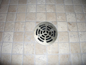 Photo: This is where the tile meets the drain, This is the correct application.