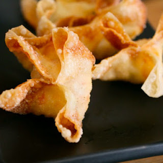 Crab Rangoons (Crab Puffs) With Sweet and Sour Sauce.