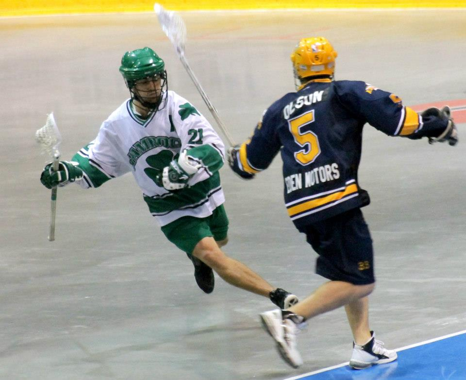 Chet Koneczny Pro Lacrosse Player Preforming The Juke Dodge in a game situation
