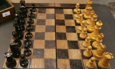Photo: The same dealer/collector who sent me the 4th spotted rook mentioned previously also sent me this photo of a set (not owned) containing identical 'spotted' K-side rooks (and knights) that appeared at a local auction in 2015.   Overall, as one might have expected, it looks to be a well-made set, although there was no information as to it's age/maker.  The pieces here do not  have the deep toffee patina that mine have, and, I gather are slightly smaller in size.