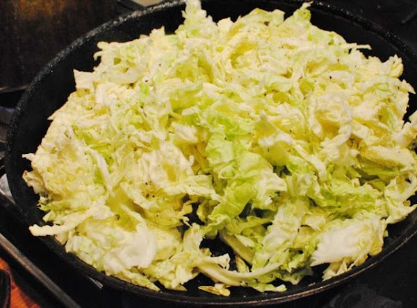 Cook cabbage in a large skillet with bacon grease or butter over low heat...