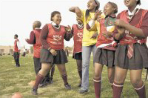 TEAM SUPPORT: Pupils at Isaac Booi school in Zwide, Port Elizabeth, encourage their team during a soccer match under the the Grassroots Soccer Programme. Grassroots Soccer helps to prevent Aids.