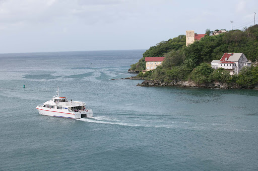 A pleasure boat exits the harbor of St. George's, Grenada, on a fall morning.