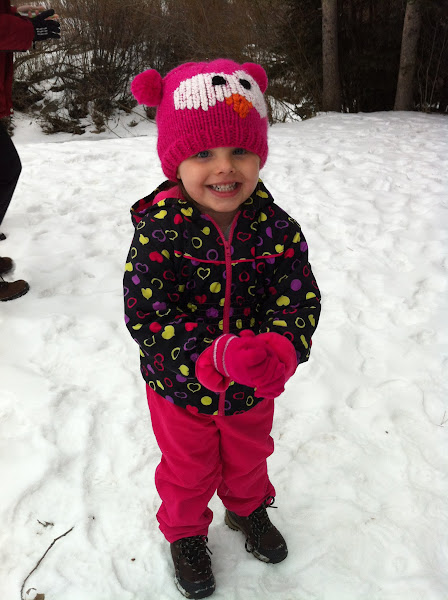 Photo: A happy girl playing in the snow