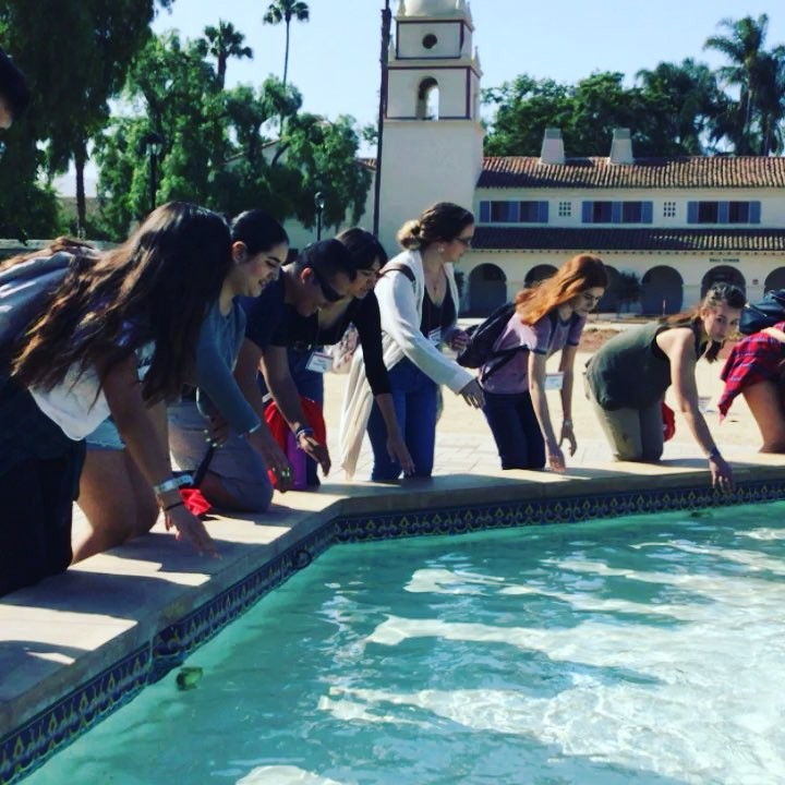 Freshmen taking the dip in the fountain.
