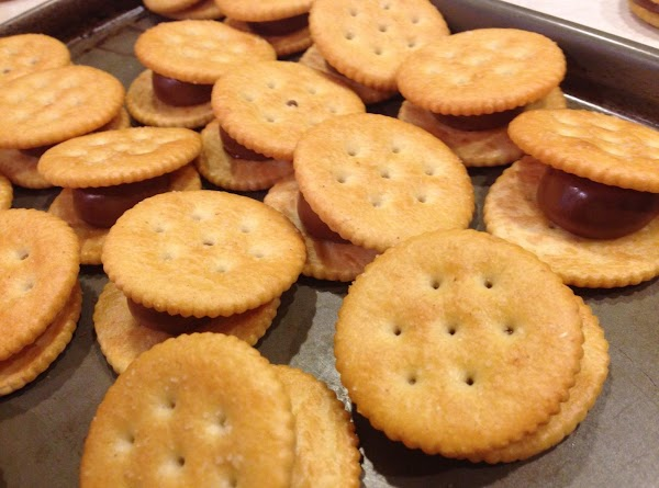 Take crackers out of oven and put a top cracker on each one and...
