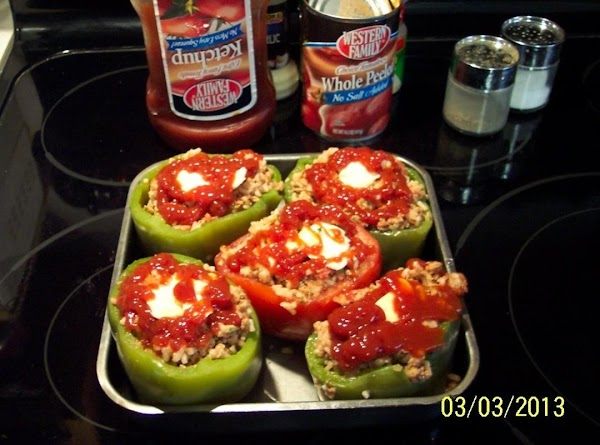 Cover the green peppers with water, and simmer 3 minutes.Drain.Brown the ground meat.Add to...