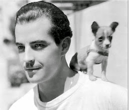 Photo: Sometimes male stars were photographed with pets, especially small dogs.  Here Ramon Navarro is 'humanized' in this way.