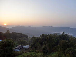 Photo: A beautiful sun rise upon Tening Town. Note the morning clouds lying in the valleys.