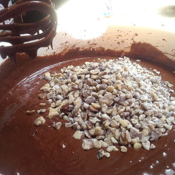 Blend the nuts with the 2 tablespoons of flour & toss to coat the...