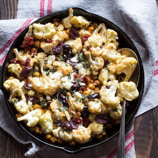 Cauliflower and Crispy Chickpea Warm Salad with Sun-Dried Tomatoes and Olives.