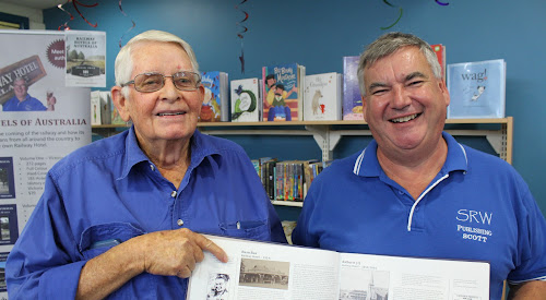 Chris Healion points to the Railway Hotel entry for Baan Baa in author Scott Whitaker's NSW volume of Railway Hotels of Australia at the Narrabri Library on Tuesday night. Mr Healion's grandfather Richard built the original Healion's Railway Hotel in Baan Baa in the early 1920s. He sold it to Ralph Chappel about 1950.