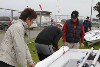 Photo: Jeff back in from Day 2 sailing and his mom and dad help pack away his boat.