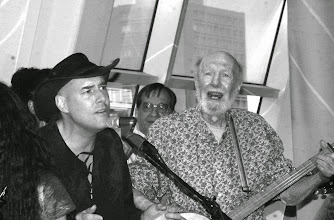 Photo: LaMotte singing with Pete Seeger