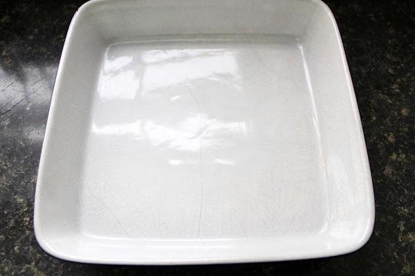 White baking dish with non-stick spray.