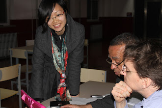 Photo: Chang Yuan (Jennifer) assists John and Hiller with the NLI session. She graduated from the College of Education in December 2012.