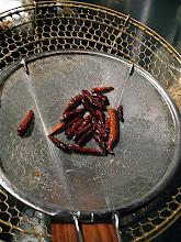 Photo: fried dried Thai chillies