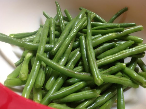 Pick through green beans remove stems then wash. You can also cook all of...