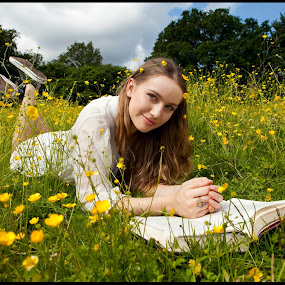 HappilyReading by Alex Newstead - People Portraits of Women ( field, girl, grass, sunny, book, smile, pretty, sun, buttercup )
