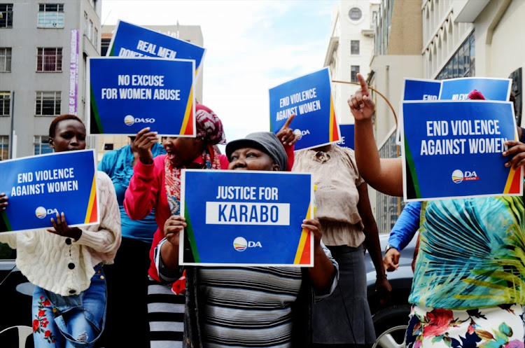 Supporters picket outside the high court demanding justice for Karabo Mokoena, the woman who was allegedly murdered by her boyfriend Sandile Mantsoe last year on March 19, 2018 in Johannesburg, South Africa.